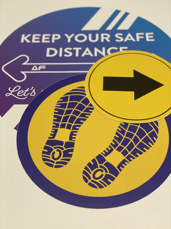 Floor Sticker Printed showing a social distancing message to keep a safe distance